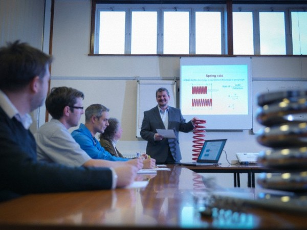 Scientist giving lecture about spring technology in conference room