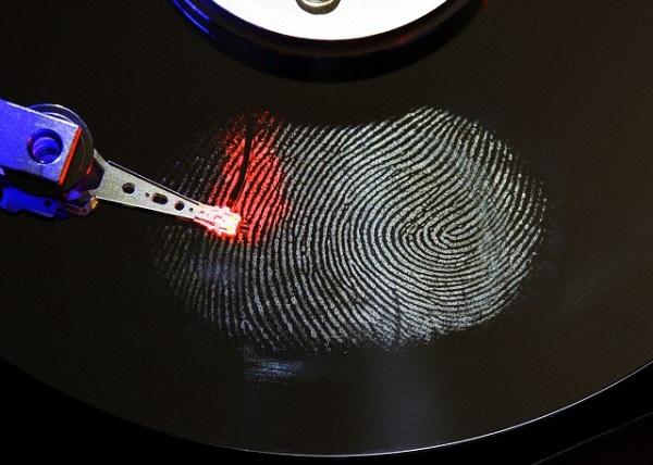 Computer hard drive, opened, read-write head on the disk, fingerprint on the disc, digital fingerprint, symbolic image