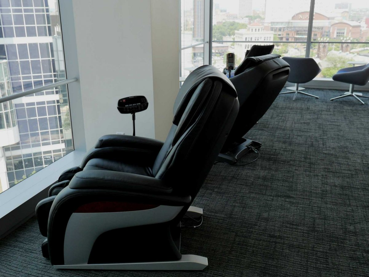 many-of-the-offices-amenities-incorporate-panasonic-products-for-example-the-massage-recliners-which-are-situated-next-to-the-floor-to-ceiling-windows-are-very-popular-after-intense-deadlines-or-meetings-in-addition-workstations-are-outfitt