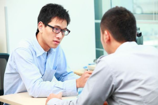 asian-businessman-talking-concerned-to-other-man