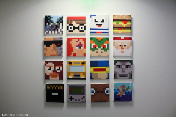 at-the-end-of-the-hall-a-gallery-wall-displays-works-of-bit-art-or-illustrations-using-large-pixels-of-solid-color-to-make-recognizable-figures-marvels-cyclops-nintendos-bowser-a-game-boy-et-santa-claus-and-others-appear