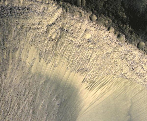 the-steep-slope-of-a-crater-shown-here-is-located-on-the-floor-of-valles-marineris--a-colossal-canyon-2500-miles-long-the-canyon-is-clearly-visible-from-space-stretching-across-the-martian-equator