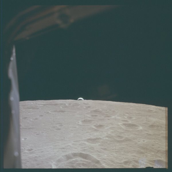 apollo-12--a-sliver-of-earth-is-visible-over-the-edge-of-the-moon