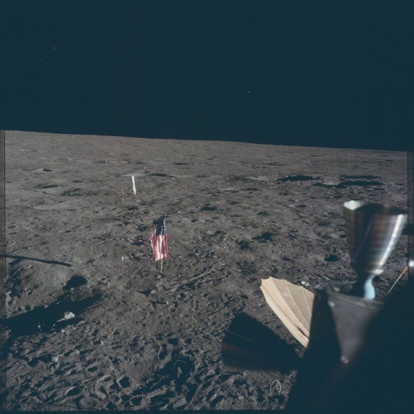 apollo-12-this-american-flag-stands-motionless-on-the-surface-because-the-moon-has-no-atmosphere-and-therefore-no-wind