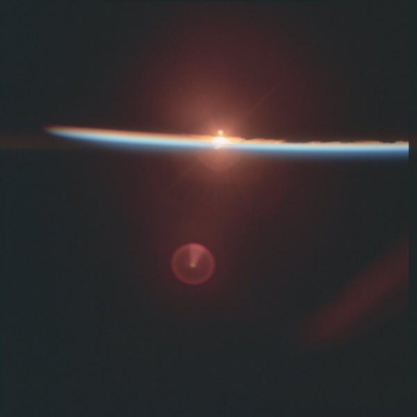 apollo-17-one-of-the-first-sunrise-photos-taken-from-space-the-sunlight-illuminates-earths-brilliant-blue-atmosphere