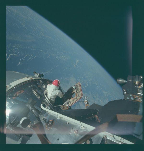 apollo-9-there-he-is-climbing-out-of-the-spacecraft-for-an-eva-earths-in-the-background
