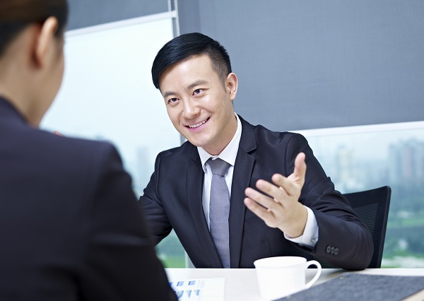 asian business executives having a discussion in office.