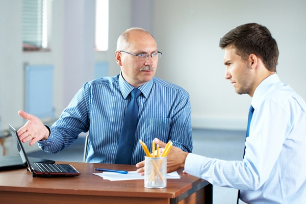 two businessman with laptop, office