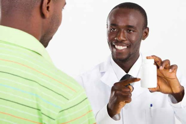 african american pharmacist and customer