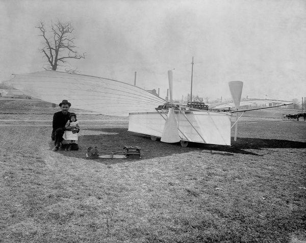 ca. 1901 --- Aviation pioneer Gustave Whitehead is pictured with his daughter Rose and plane number 21. Some aviation historians believe Gustave Whitehead preceeded the Wright brothers by as much as three years with a manned flight. --- Image by © CORBIS
