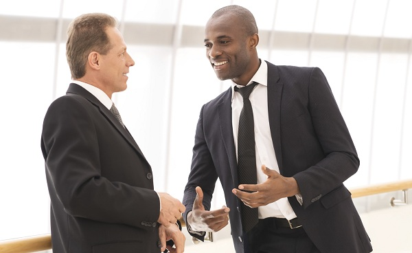 Business communication. Two cheerful business men talking to each other and gesturing