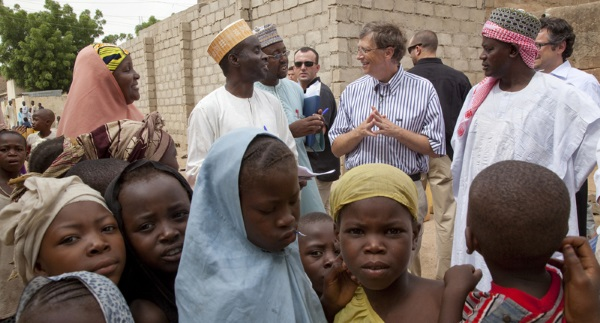 NIGERIA / Kano / 6 June 2010 Bill Gates, Co-chair of the Bill & Melinda Gates Foundation, walks in a street in the Gwammaja ward, Dala LGA, Kano on 6 June 2010 during Polio Immunization Plus days. He was accompanied by Hajiya Rabi, Ward Focal Person, Dr. Abdulrahman Yakubu, Kano State Immunization Officer, Ahmed Usman, ward leader, Dr. Takai of WHO & Michael Galway of BMGF. Bill Gates visited Gwammaja to review progress of the polio program and to congratulate health workers and leaders for their efforts.