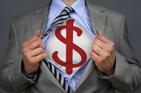 Businessman in classic superman pose tearing his shirt open to reveal a dollar symbol on chest concept for human financial advisor, success or recruitment