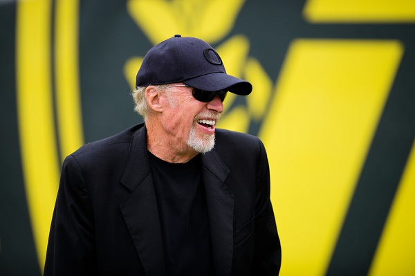 """Oregon alum & prominent donor Phil Knight laughs as the Autzen student section chants """"Uncle Phil!"""" as he enters the field. The No. 2 Oregon Ducks play the Tennessee Volunteers at Autzen Stadium in Eugene, Ore. on Sept. 14, 2013. (Michael Arellano/Emerald)"""