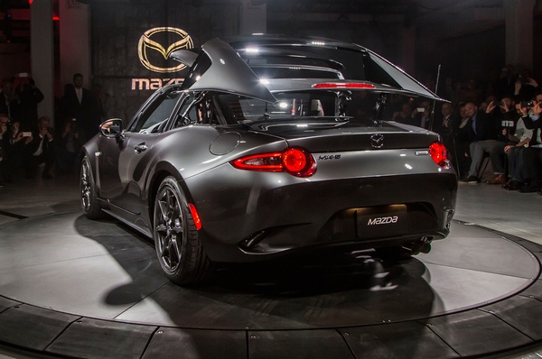 2017-Mazda-MX-5-Miata-RF-on-stage-rear-side-view-top-folding