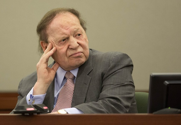 FILE - In this Friday, April 5, 2013, file photo, Las Vegas Sands Corp. CEO Sheldon Adelson testifies in Clark County district court in Las Vegas. Attorneys began closing arguments Thursday May 9, 2013, in the dispute between Las Vegas Sands and a fixer who says he helped the casino giant win a license in the Chinese gambling enclave of Macau. (AP Photo/Julie Jacobson, File)