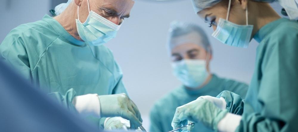 surgeon performing operation with his nurse and anaesthetist