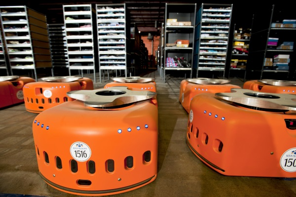 Kiva Solution robots sit in a warehouse at Acumen Brands on Friday, August 11, 2011, in Fayetteville, Ark. Photographer: Beth Hall/Bloomberg News +++ for story by Ashley Lutz +++