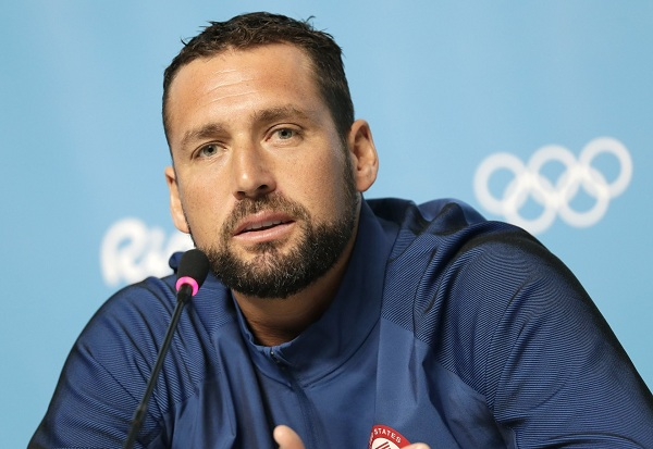 United States' men's water polo player Merrill Moses speaks during a news conference ahead of the 2016 Summer Olympics in Rio de Janeiro, Brazil, Friday, Aug. 5, 2016. (AP Photo/Sergei Grits)