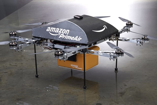 """An Amazon PrimeAir drone is shown in this publicity photo released to Reuters on December 2, 2013. Amazon.com CEO Jeff Bezos told the CBS television program """"60 Minutes"""" that the company is testing the use of delivery drones that could deliver packages that weigh up to five pounds (2.3 kg), which represents roughly 86 percent of packages that Amazon delivers, he said. REUTERS/Amazon.com/Handout via Reuters(UNITED STATES - Tags: BUSINESS SCIENCE TECHNOLOGY) ATTENTION EDITORS - THIS IMAGE WAS PROVIDED BY A THIRD PARTY. FOR EDITORIAL USE ONLY. NOT FOR SALE FOR MARKETING OR ADVERTISING CAMPAIGNS. NO SALES. NO ARCHIVES.THIS PICTURE IS DISTRIBUTED EXACTLY AS RECEIVED BY REUTERS, AS A SERVICE TO CLIENTS"""
