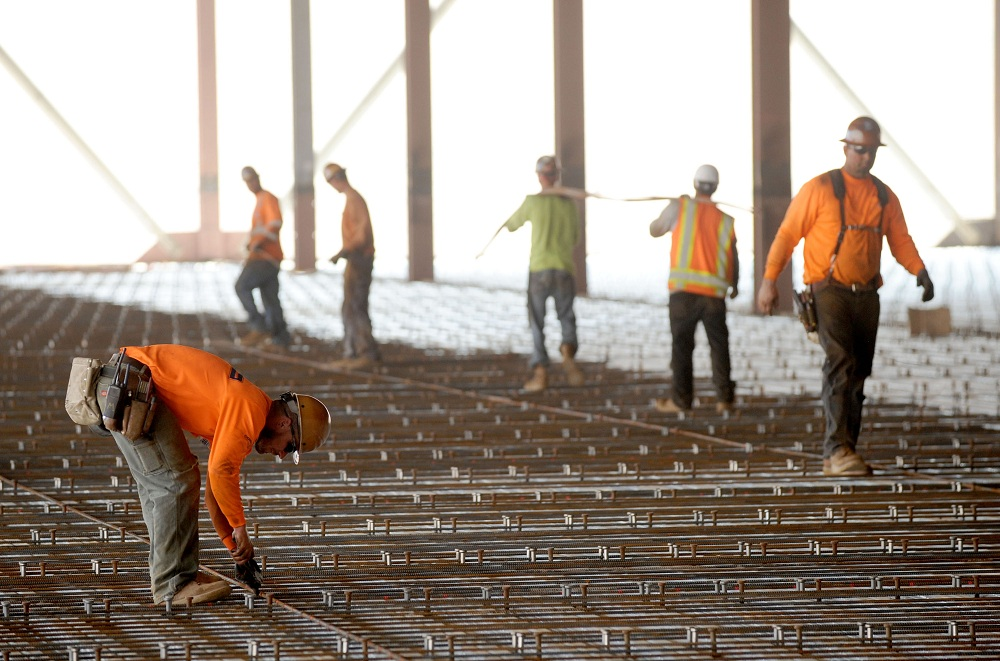 Workers continue construction work at the Tesla Gigafactory under construction near Sparks, Nevada, U.S. July 26, 2016. REUTERS/James Glover II - RTSJT84