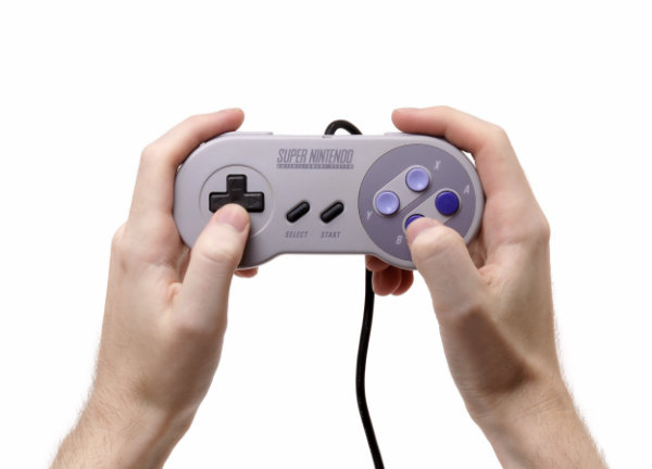 snes-controller-in-hand-w600