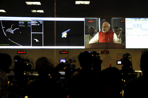 India's Prime Minister Narendra Modi is seen on a screen addressing scientists and engineers of the Indian Space Research Organization (ISRO) after the successfully insert of Mars Orbiter Mission (MOM) Mangalyaan probe into orbit around Mars, at the ISRO Telemetry Tracking and Command Network (ISTRAC) in Bengaluru, India, on Sept. 24. 2014.