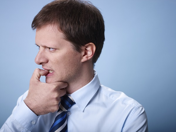 nervous business man biting finger nails