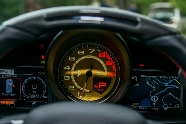 the-instrument-panel-it-combines-analog-and-digital-features-the-two-small-screens-on-the-le_crop_600x400
