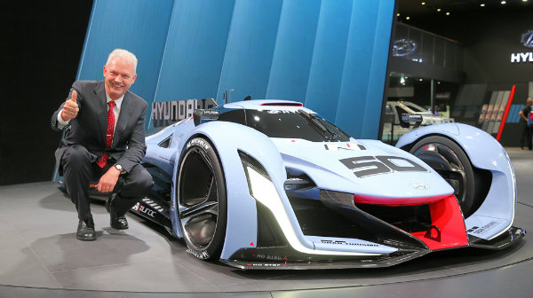 Albert Biermann, vice president of Hyundai Motor Group, poses with the N 2025 Vision Gran Turismo