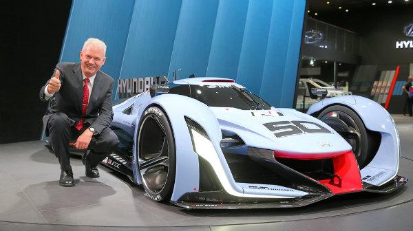 Albert Biermann, vice president of Hyundai Motor Group, poses with the N 2025 Vision Gran Turismo
