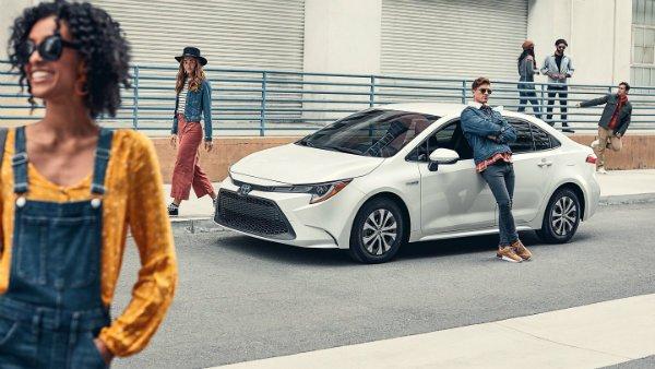 Toyota-Corolla-White-versus-Tesla-Model-3