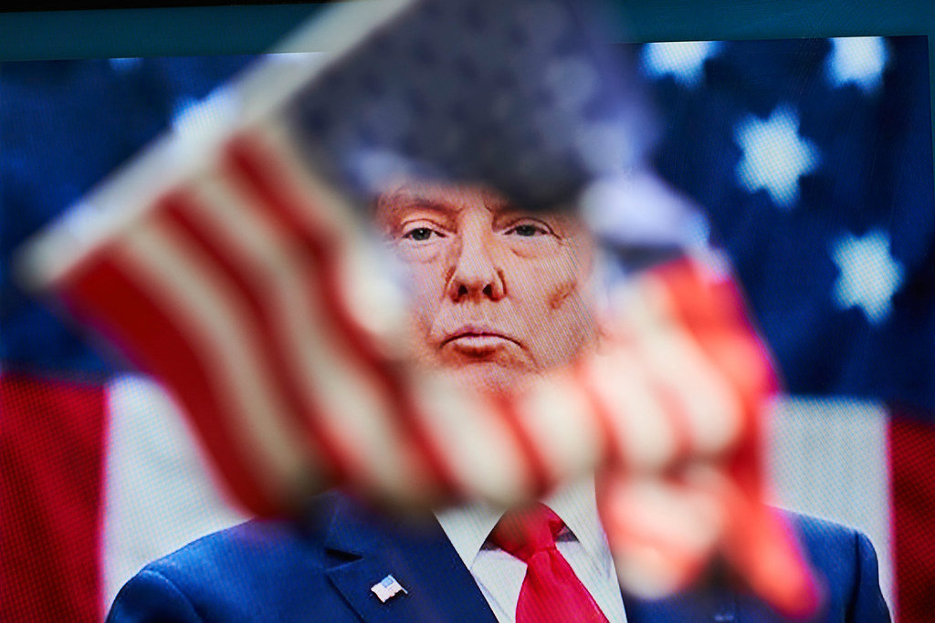 donald trump face through the torn us flag capitol chaos aftermath twitter facebook instagram snapchat ban president trumps accounts w1200 پلتفرم‌زدایی پرزیدنت؛ وقتی سیلیکون ولی در برابر ترامپ ایستاد اخبار IT