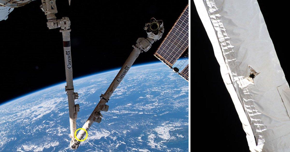 بازوی رباتیک ایستگاه فضایی بینالمللی در برخورد با یک زباله فضایی آسیب دید